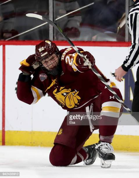 Jared Thomas of the MinnesotaDuluth Bulldogs celebrates his goal in the first period against the Ohio State Buckeyes during the semifinals of the...