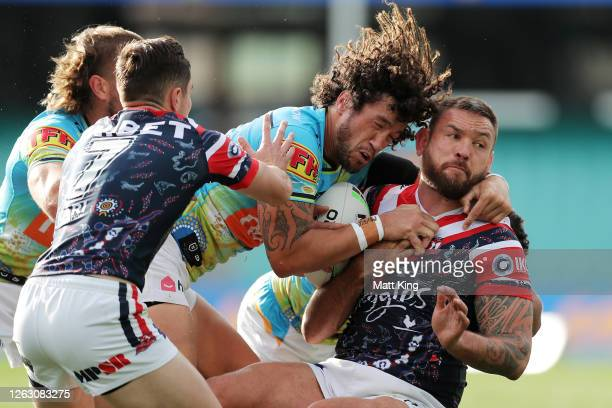 Jared Waerea-Haregreaves of the Roosters is tackled by Kevin Proctor of the Titans during the round 12 NRL match between the Sydney Roosters and the...