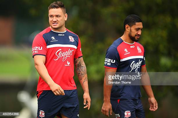 Jared WaereaHargreaves and Isaac Liu of the Roosters walk to a Sydney Roosters NRL training session at Kippax Lake on June 10 2014 in Sydney Australia