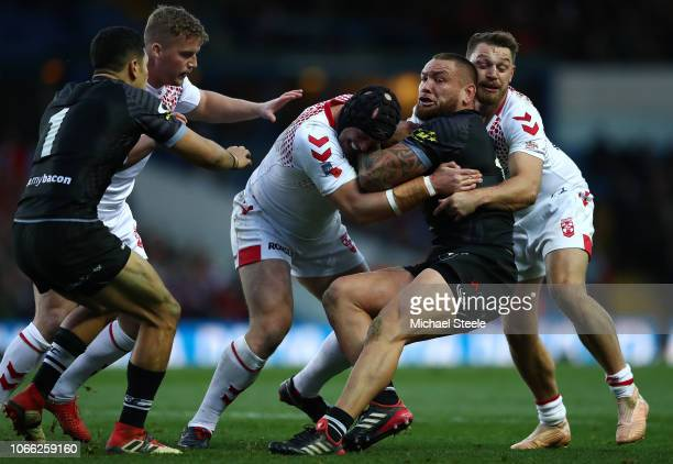 Jared WaereaHargreaves of New Zealand is tackled by Elliott Whitehead and Chris Hill of England during the 3rd International Series match between...