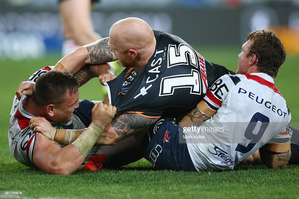 Jared Waerea-Hargreaves of the Roosters and Keith Galloway of the Wests Tigers scuffle as Jake Friend of the Roosters pulls back Galloway during the round 20 NRL match between the Wests Tigers and the Sydney Roosters at ANZ Stadium on July 24, 2015 in Sydney, Australia.