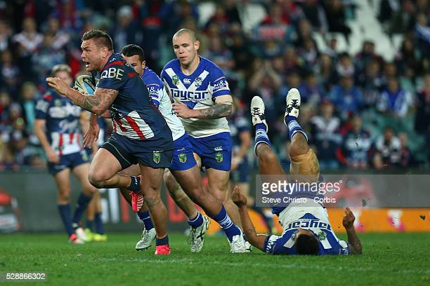 Jared Waerea-Hargreaves of the Roosters breaks the tackle of Bulldog's Michael Lichaa during the round 21 NRL match between the Canterbury Bulldogs...