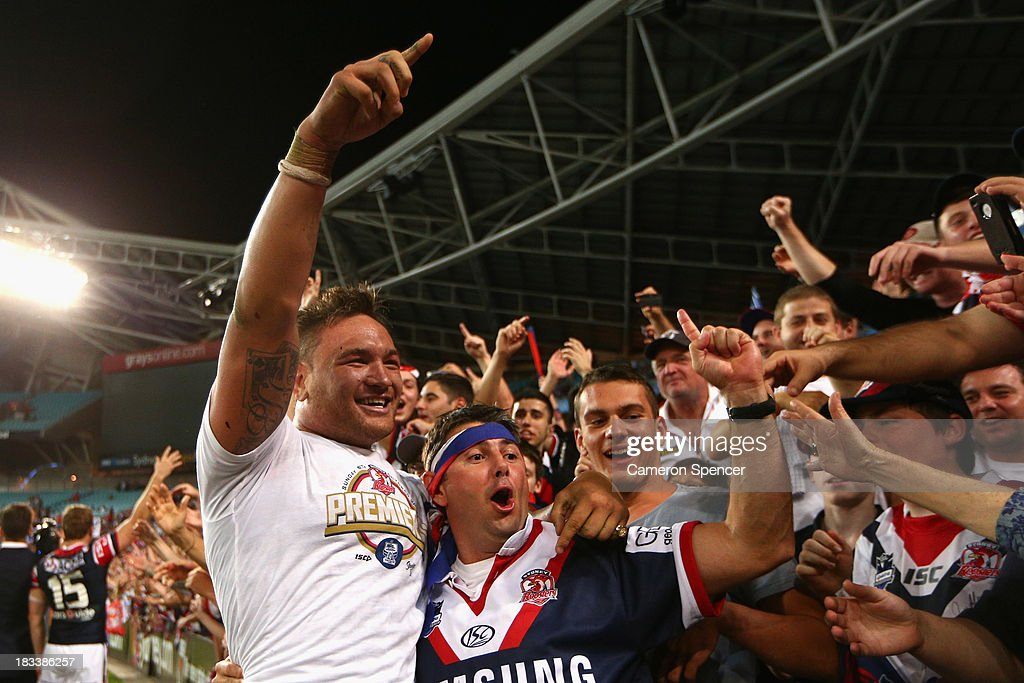 Jared Waerea-Hargreaves of the Roosters celebrates with fans after winning the 2013 NRL Grand Final match between the Sydney Roosters and the Manly Warringah Sea Eagles at ANZ Stadium on October 6, 2013 in Sydney, Australia.