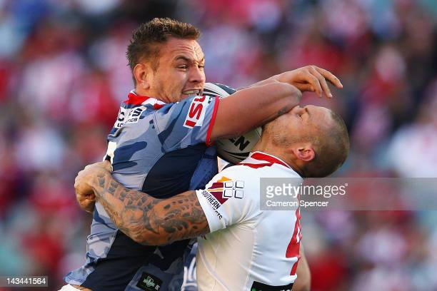 Jared Waerea-Hargreaves of the Roosters fends off Matt Cooper of the Dragons during the round eight NRL match between the St George Illawarra Dragons...