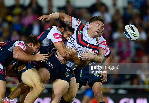 Jared WaereaHargreaves of the Roosters gets a pass away desite the tackle of James Tamou of the Cowboys during the round 10 NRL match between the...