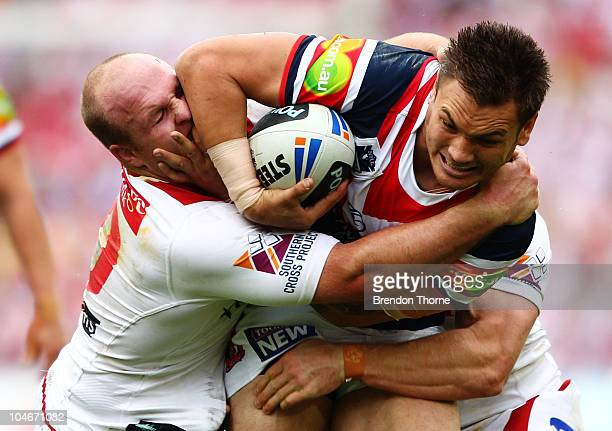 Jared WaereaHargreaves of the Roosters is tackled by Michael Weyman of the Dragons during the NRL Grand Final match between the St George Illawarra...
