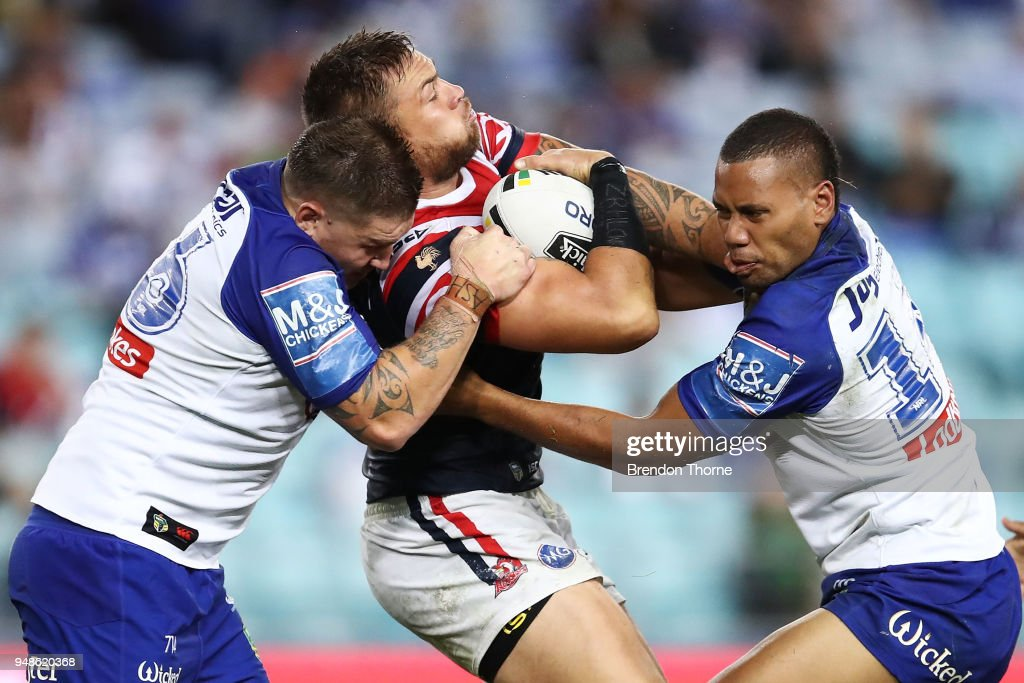 Jared Waerea-Hargreaves of the Roosters is tackled by the Bulldogs defence during the round seven NRL match between the Canterbury Bulldogs and the Sydney Roosters at ANZ Stadium on April 19, 2018 in Sydney, Australia.
