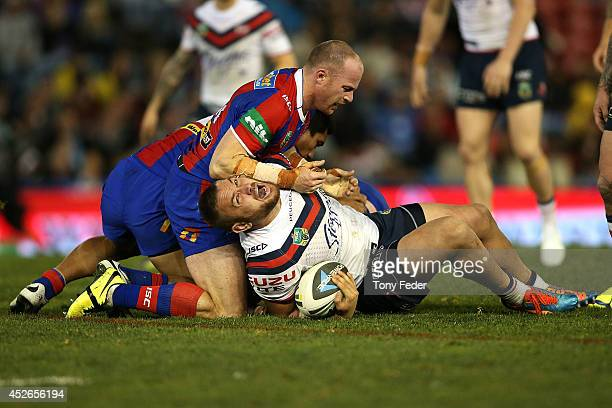 Jared WaereaHargreaves of the Roosters is tackled by the Knights defence during the round 20 NRL match between the Newcastle Knights and the Sydney...