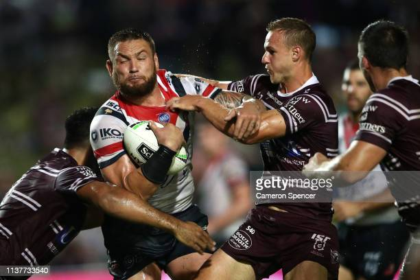 Jared WaereaHargreaves of the Roosters is tackled during the round two NRL match between the Manly Sea Eagles and the Sydney Roosters at Lottoland on...