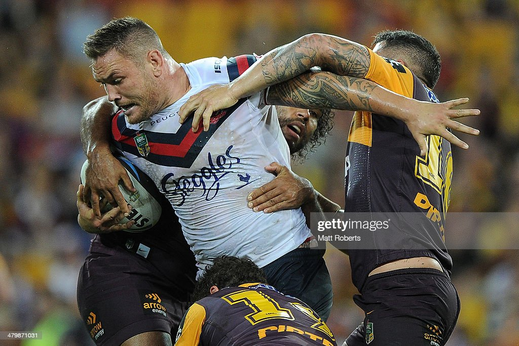 Jared Waerea-Hargreaves of the Roosters is tackled during the round three NRL match between the Brisbane Broncos and the Sydney Roosters at Suncorp Stadium on March 21, 2014 in Brisbane, Australia.