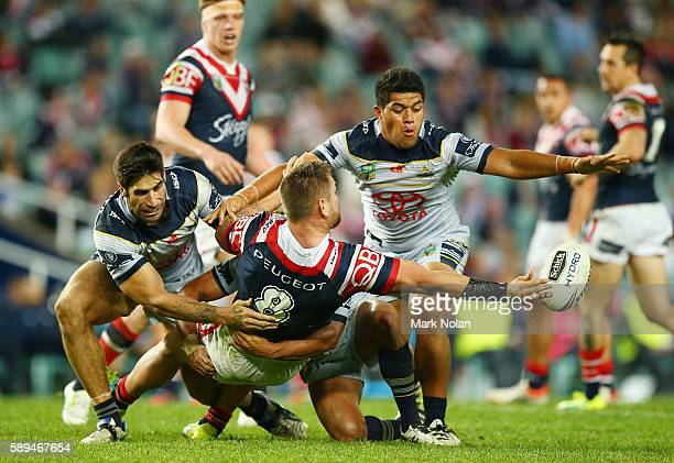Jared WaereaHargreaves of the Roosters offloads during the round 23 NRL match between the Sydney Roosters and the North Queensland Cowboys at Allianz...