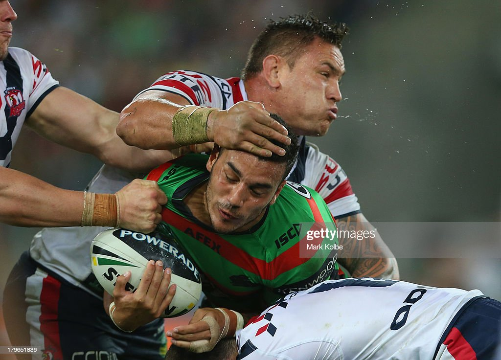 Jared Waerea-Hargreaves of the Roosters tackles Dylan Farrell of the Rabbitohs during the round 26 NRL match between the South Sydney Rabbitohs and the Sydney Roosters at ANZ Stadium on September 6, 2013 in Sydney, Australia.