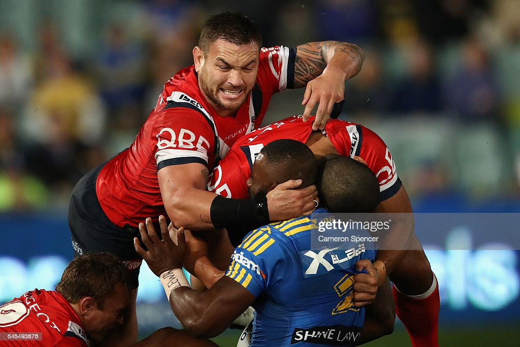 Jared Waerea-Hargreaves of the Roosters tackles Semi Radradra of the Eels during the round 18 NRL match between the Parramatta Eels and the Sydney Roosters at Pirtek Stadium on July 8, 2016 in Sydney, Australia.