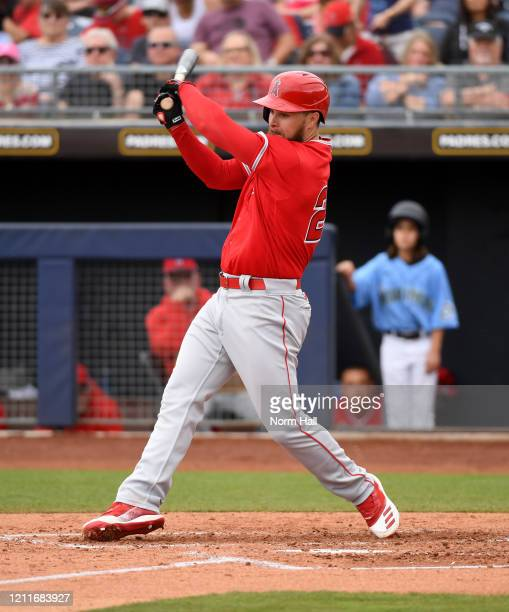 Jared Walsh of the Los Angeles Angels follows through on a swing during a spring training game against the Seattle Mariners at Peoria Stadium on...