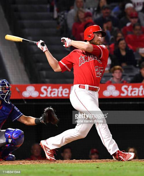 Jared Walsh of the Los Angeles Angels of Anaheim hits a walk off pinch hit single in the ninth inning of the game to score Kole Calhoun of the Los...