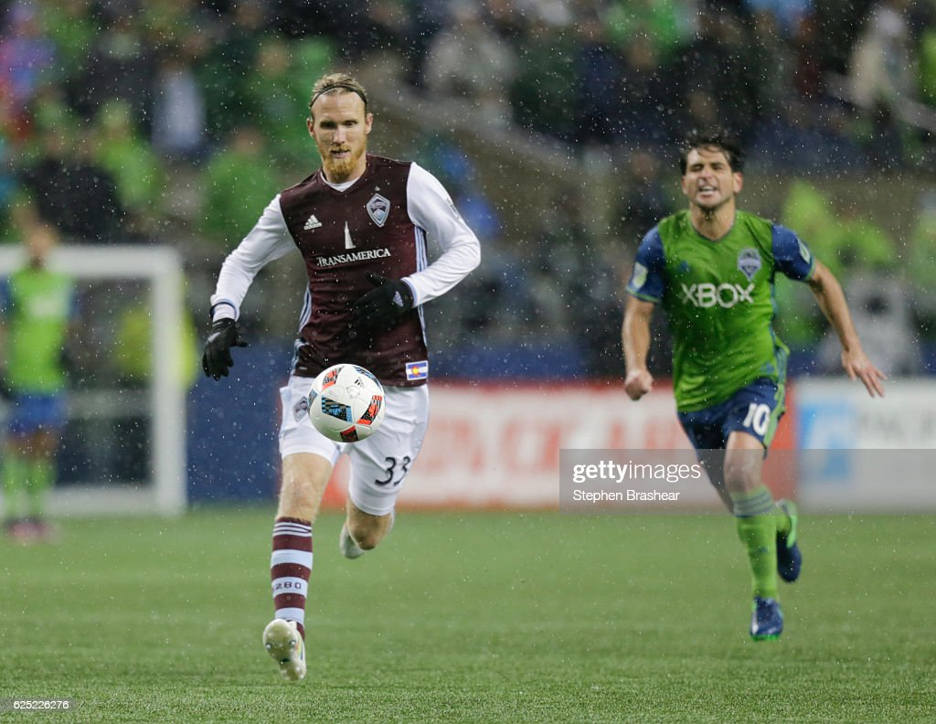 Jared Watts #33, left, of the Colorado Rapids and Nicolas Lodeiro #10 chase down the ball during the second half of a match in the first leg of the Western Conference Finals at CenturyLink Field on November 22, 2016 in Seattle, Washington. The Sounders won the match 2-1.
