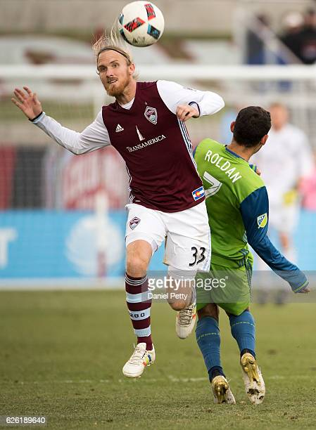 Jared Watts of Colorado Rapids heads the ball against Cristian Roldan of Seattle Sounders during the second half of the second leg of the Western...