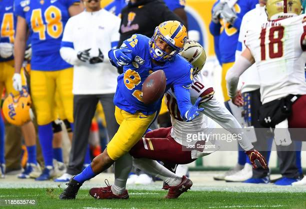 Jared Wayne of the Pittsburgh Panthers can't make a catch in front of Brandon Sebastian of the Boston College Eagles in the first quarter at Heinz...