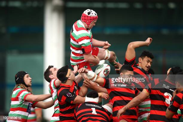Andrew Petelo of Poneke is tackled during the Wellington Club Rugby match between Poneke and Hutt Old Boys Marist at Nairnville Recreation Centre on...
