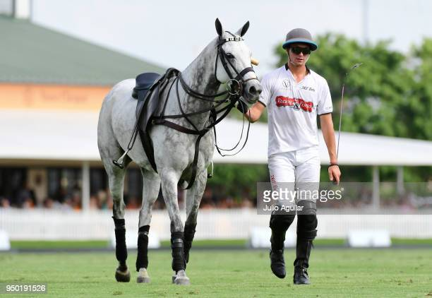 Jared Zenni of The Daily Racing Form walks his horse off the field in the US Open Polo Championship against Valiente April 22 2018 in Wellington...