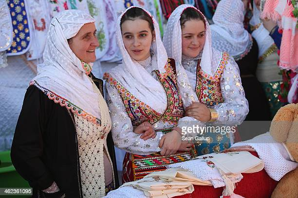 Jarei Arnautska and her daughters Fatme and Gultena arrive at the house of bride Fatme Inus to see items of her dowry on display on the first day of...