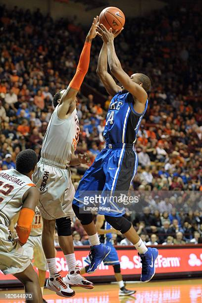 Jarell Eddie of the Virginia Tech Hokies blocks a shot by Rasheed Sulaimon of the Duke Blue Devils at Cassell Coliseum on February 21 2013 in...