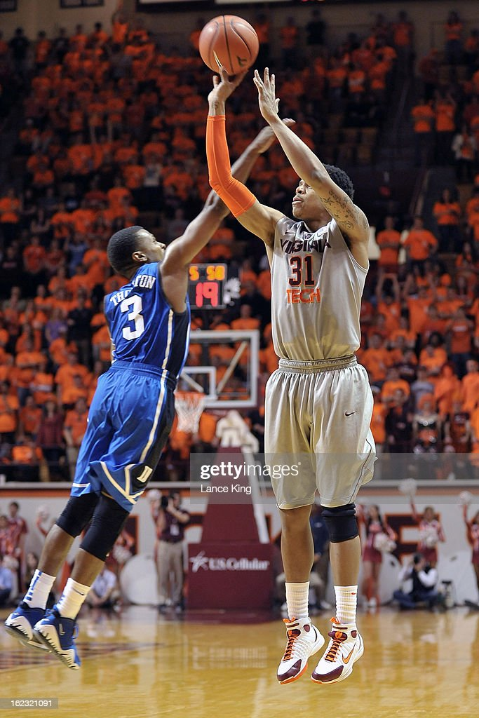 Jarell Eddie #31 of the Virginia Tech Hokies puts up a shot against Tyler Thornton #3 of the Duke Blue Devils at Cassell Coliseum on February 21, 2013 in Blacksburg, Virginia. Duke defeated Virginia Tech 88-56.