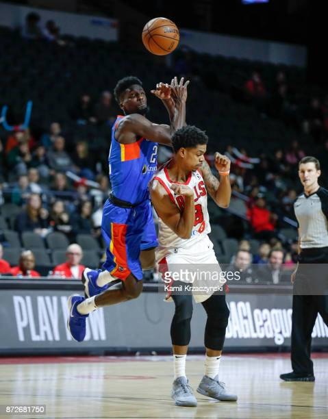 Jarell Eddie of the Windy City Bulls fouls Daniel Hamilton of the Oklahoma City Blue during the first quarter of an NBA GLeague game on November 10...