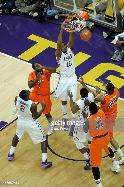 Jarell Martin of the LSU Tigers dunks in front of KT Harrell of the Auburn Tigers during a game at the Pete Maravich Assembly Center on February 8...