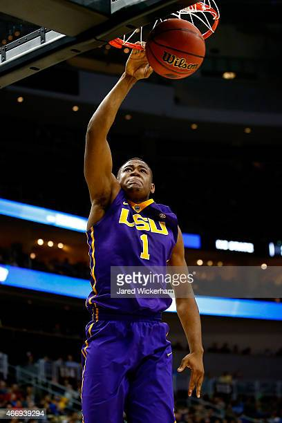 Jarell Martin of the LSU Tigers dunks the ball in the first half against the North Carolina State Wolfpack during the second round of the 2015 NCAA...