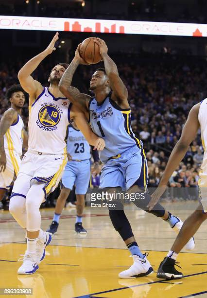 Jarell Martin of the Memphis Grizzlies drives on Omri Casspi of the Golden State Warriors at ORACLE Arena on December 20 2017 in Oakland California...