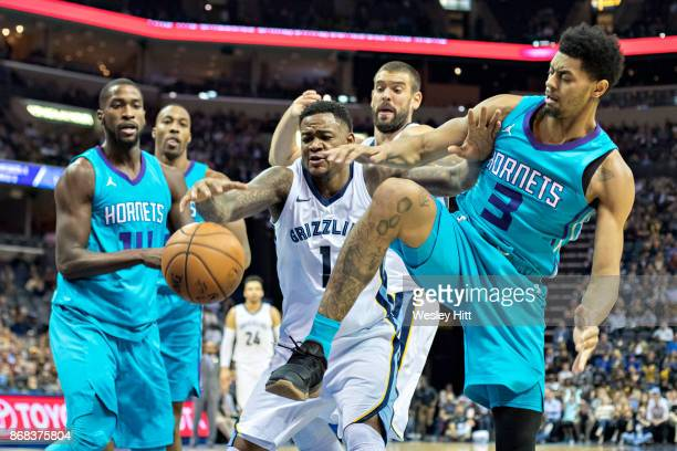 Jarell Martin of the Memphis Grizzlies fights for a rebound with Jeremy Lamb of the Charlotte Hornets at the FedEx Forum on October 30 2017 in...