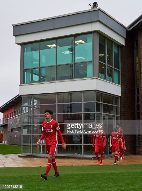Jarell Quansah leads the Liverpool players as they make their way to the pitch at Melwood Training Ground on November 21, 2020 in Liverpool, England.