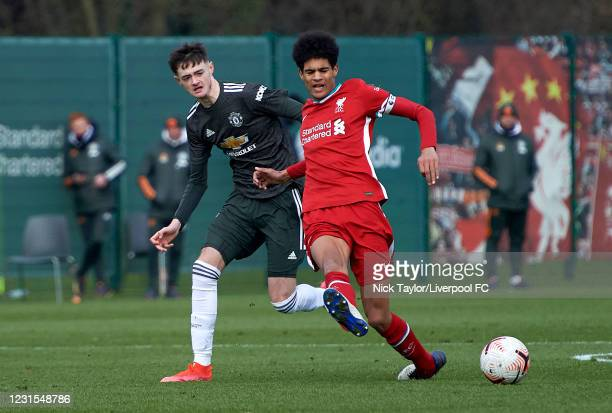 Jarell Quansah of Liverpool and Joe Hugill of Manchester United in action during the U18 Premier League game between Liverpool and Manchester United...