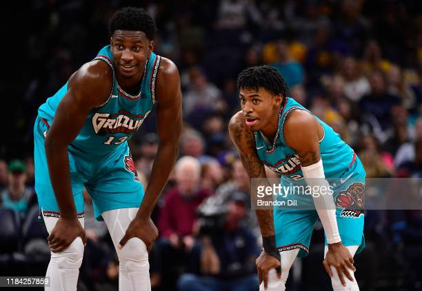 Jaren Jackson Jr #13 and Ja Morant of the Memphis Grizzlies talk on the court during a game against the Los Angeles Lakers at FedExForum on November...