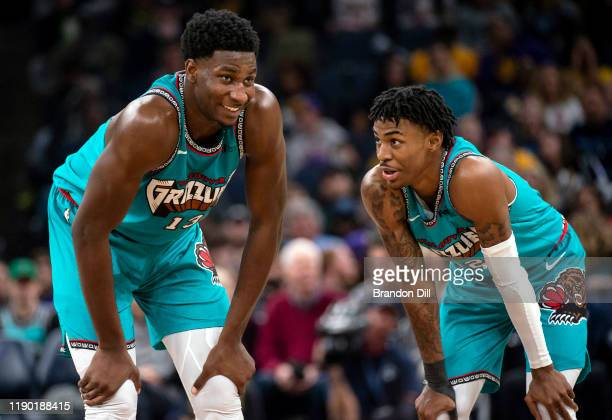 Jaren Jackson Jr #13 and Ja Morant of the Memphis Grizzlies talk on the court during the game against the Los Angeles Lakers at FedExForum on...
