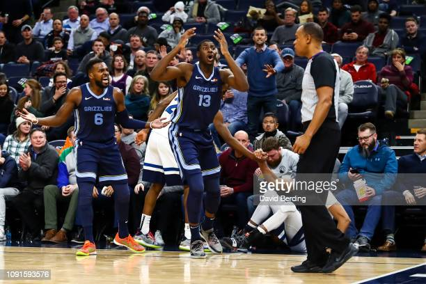 Jaren Jackson Jr #13 and Shelvin Mack of the Memphis Grizzlies react after Jackson Jr is called for a foul against the Minnesota Timberwolves in the...