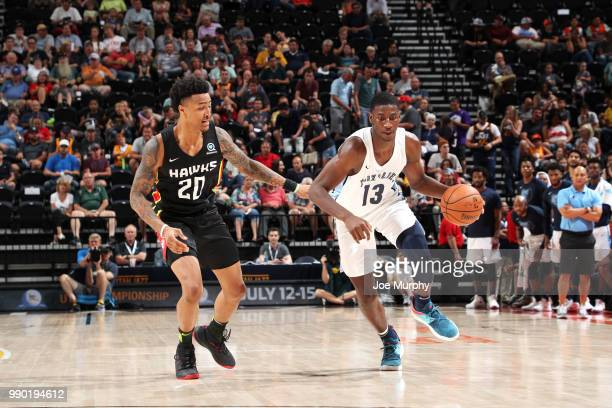Jaren Jackson Jr #13 of the handles the ball against Jason Collins of the Atlanta Hawks during the 2018 Summer League at the Vivint Smart Home Arena...