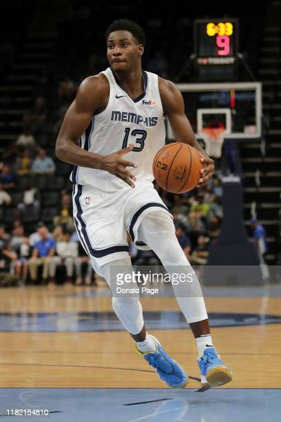 Jaren Jackson Jr #13 of the Memphis Grizzlies dribbles in the preseason game against the New Zealand Breakers at FedExForum on October 08 2019 in...