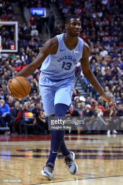 Jaren Jackson Jr #13 of the Memphis Grizzlies dribbles the ball during the first half of an NBA game against the Toronto Raptors at Scotiabank Arena...