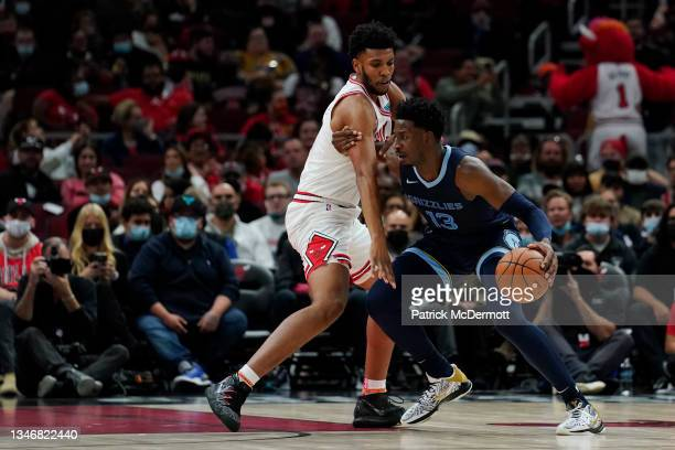Jaren Jackson Jr. #13 of the Memphis Grizzlies dribbles the ball against Tony Bradley of the Chicago Bulls in the first half during a preseason game...