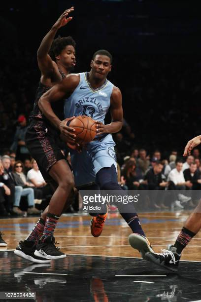 Jaren Jackson Jr #13 of the Memphis Grizzlies drives against Ed Davis of the Brooklyn Nets during their game at the Barclays Center on November 30...