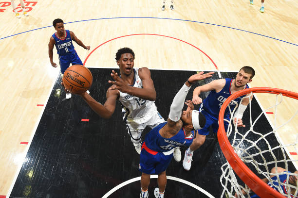 Jaren Jackson Jr. #13 of the Memphis Grizzlies drives to the basket against the LA Clippers on April 21, 2021 at STAPLES Center in Los Angeles,...