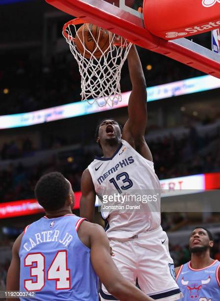 Jaren Jackson Jr #13 of the Memphis Grizzlies dunks over Wendell Carter Jr #34 of the Chicago Bulls at the United Center on December 04 2019 in...