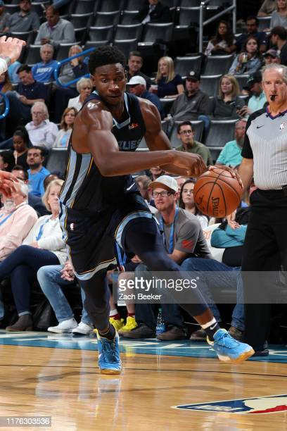 Jaren Jackson Jr #13 of the Memphis Grizzlies handles the ball during a preseason game against the Oklahoma City Thunder on October 16 2019 at...