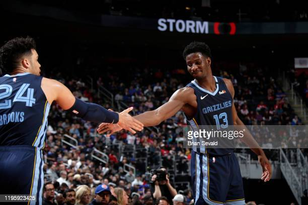 Jaren Jackson Jr #13 of the Memphis Grizzlies high fives his teammates during the game against the Detroit Pistons on January 24 2020 at Little...