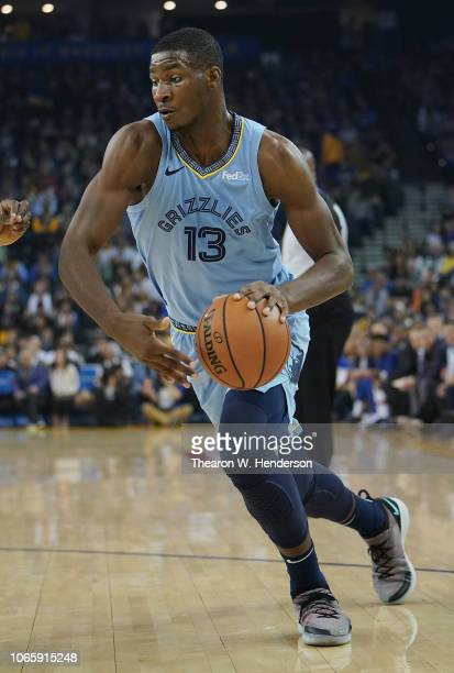 Jaren Jackson Jr #13 of the Memphis Grizzlies looks to drive to the basket against the Golden State Warriors during an NBA basketball game at ORACLE...