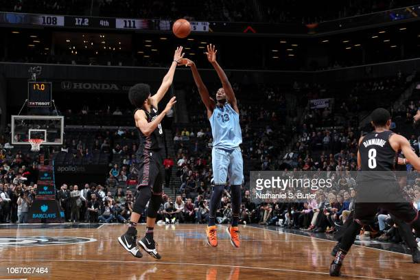 Jaren Jackson Jr #13 of the Memphis Grizzlies makes a three point basket to tie the game late in the 4th quarter against the Brooklyn Nets on...