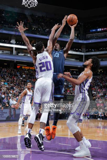 Jaren Jackson Jr #13 of the Memphis Grizzlies shoots against Harry Giles of the Sacramento Kings on October 24 2018 at Golden 1 Center in Sacramento...