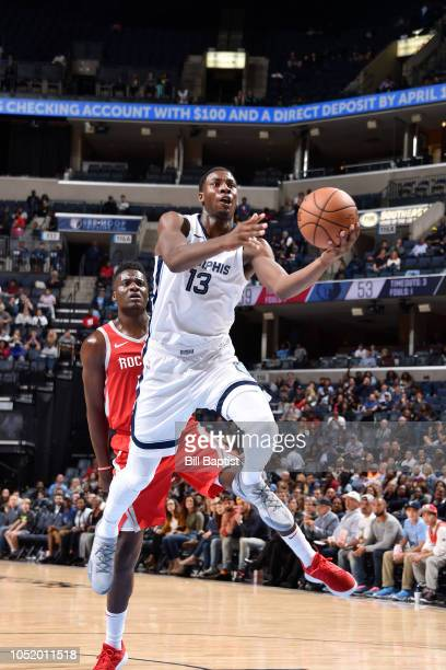 Jaren Jackson Jr #13 of the Memphis Grizzlies shoots the ball against the Houston Rockets on October 12 2018 at the FedExForum in Memphis Tennessee...